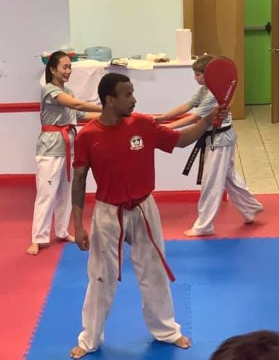 Taekwondo Adult class kicking practice